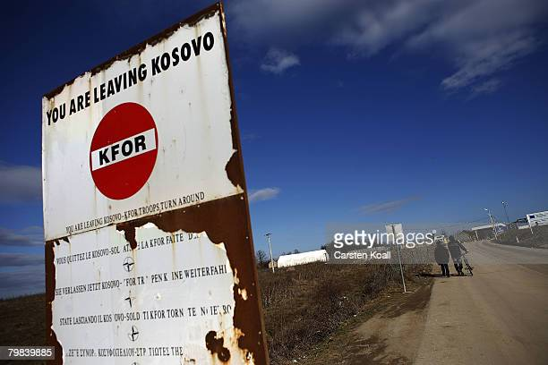 A signboard refers to the borderline of Kosovo in front of a checkpoint to Serbia on February 19 2008 in Merdar Kosovo Europe's major powers and the...