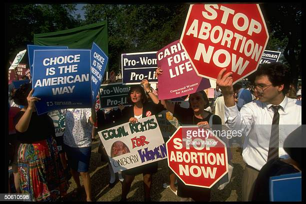 Signcarrying prochoice prolife advocates clashing outside Supreme Court demonstrating against Pennsylvania case ruling imperiling 1973 Roe vs Wade...