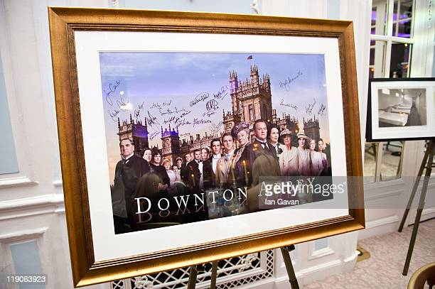 A signed and framed poster of Downton Abbey awaits auction during 'An Evening With Downton Abbey Raising Money For Merlin The Medical Relief Charity'...