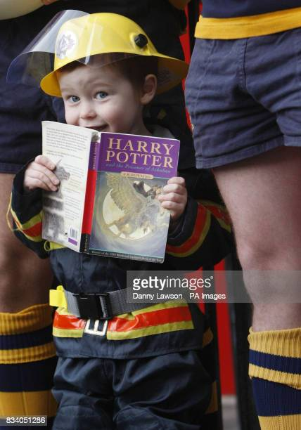 A signed copy of Harry Potter is held by Portobello Rugby Club mascot threeyearold Jack Henderson to promote a Harry Potter book auction