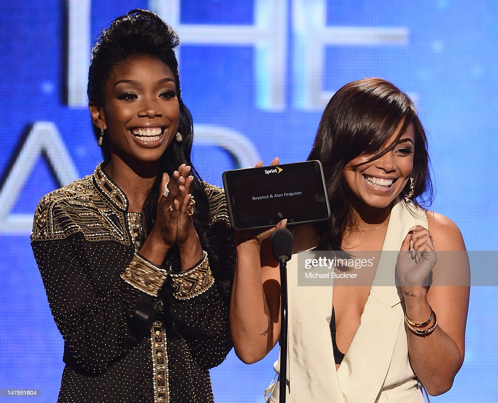 Signer Brandy Norwoord and actress <a gi-track='captionPersonalityLinkClicked' href=/galleries/search?phrase=Lauren+London&family=editorial&specificpeople=629462 ng-click='$event.stopPropagation()'>Lauren London</a> present an award onstage during the 2012 BET Awards at The Shrine Auditorium on July 1, 2012 in Los Angeles, California.