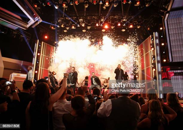 Signers Brian Littrell Nick Carter AJ McLean Kevin Richardson and Howie D of the Backstreet Boys perform onstage during the 52nd Academy of Country...