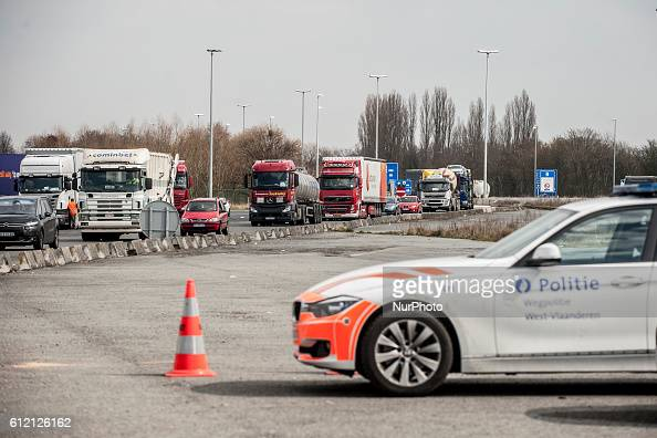 A significant slowdown is taking place at the border from Belgium Vehicles are brought on a taxiway A Neuville en Ferrain Northern France March 22...