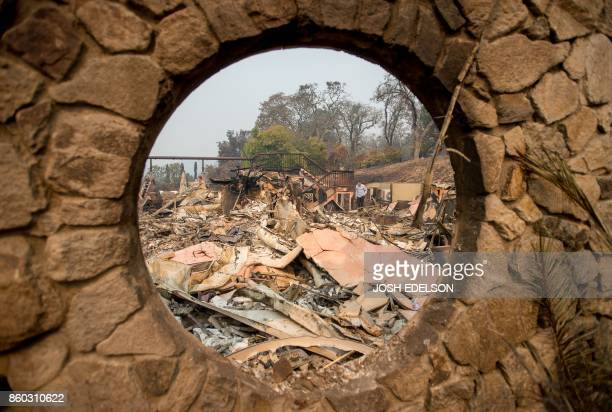 TOPSHOT Signorello Estate Winery owner Ray Signorello who flew in from Canada views the remains of his winery in Napa California on October 11 2017...