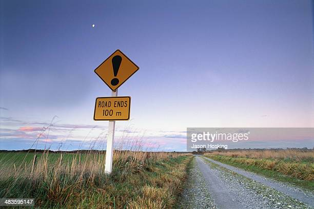 Signpost beside road at dusk, South Island, New Zealand