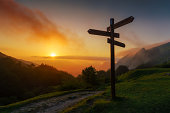 signpost in the mountain at the sunset