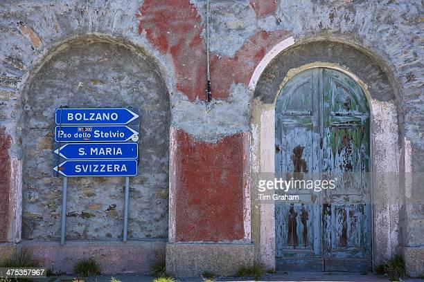 Signpost on The Stelvio Pass Passo dello Stelvio Stilfser Joch in Northern Italy points to Bolzano Santa Maria and Svizzera