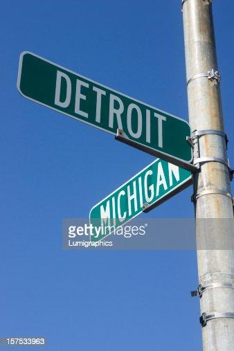 Signpost signaling Detroit and Michigan