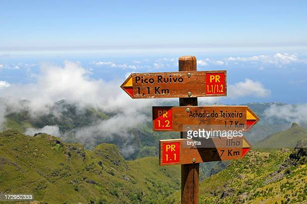 Signposts with distances  for hikers in the mountains, Madeira Island