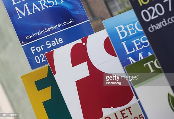 Signs advertise residential properties for sale and to let in London UK on Thursday June 10 2010 UK house prices rose to the highest in almost two...