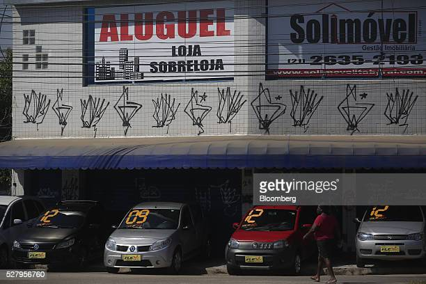Signs advertising available office space for rent are displayed aboce a car dealership in Itaborai Brazil on Tuesday April 12 2016 Just 30 miles east...