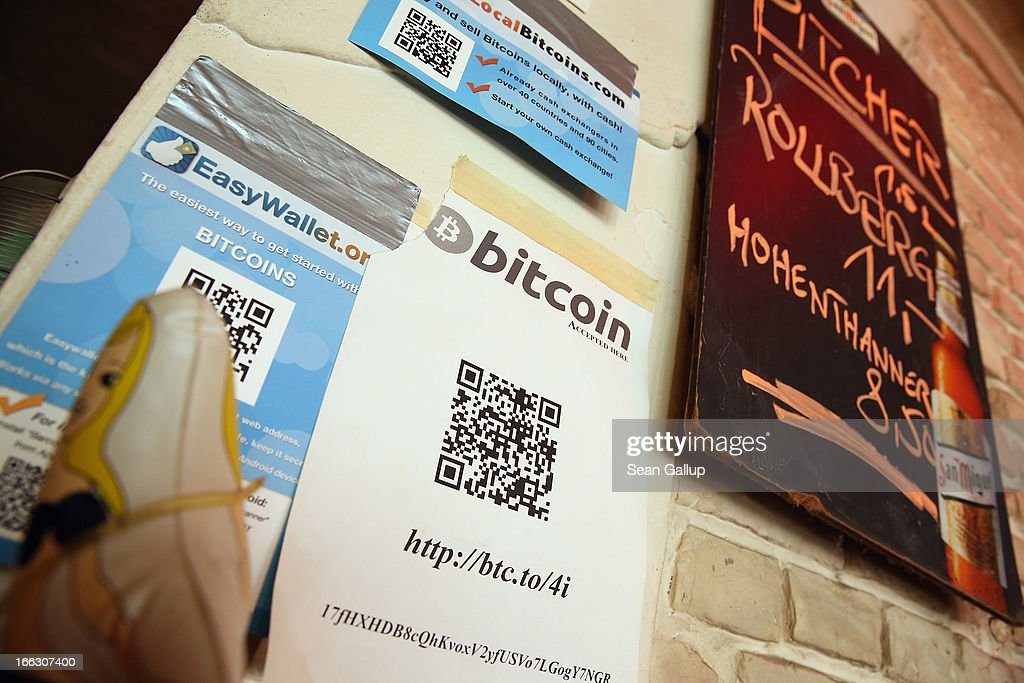 Signs advertising Bitcoins hang behind the bar at a pub, where Bitcoins are also accepted for payment, on April 11, 2013 in Berlin, Germany. Bitcoins are a digital currency traded on the MTGox exchange, and the value of the virtual money fluctuated from USD 260 per bitcoin down to USD 130 per bitcoin yesterday and recovered somewhat in trading today.