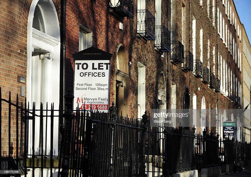 Signs advertising commercial office space to let stand outside Georgian properties in Dublin, Ireland, on Thursday, Dec. 27, 2012. Ireland will take over the EU presidency in January as the euro-area wrestles with putting the European Central Bank in charge of lenders within the currency union and other participating nations. Photographer: Aidan Crawley/Bloomberg via Getty Images