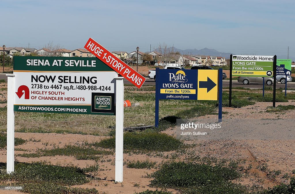 Signs advertising new housing developments are posted at an intersection on March 6, 2013 in Gilbert, Arizona. In 2008, Phoenix, Arizona was at the forefront of the U.S. housing crisis with home prices falling 55 percent between 2005 and 2011 leaving many developers to abandon development projects. Phoenix is now undergoing a housing boom as sale prices have surged 22.9 percent, the highest price increase in the nation, and homebuilders are scrambling to buy up land.