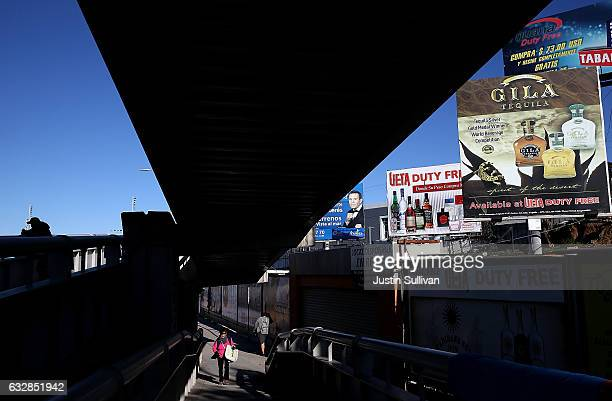 Signs advertising tequila and duty free stores are displayed near the San Ysidro Port of Entry to the United States on January 27 2017 in Tijuana...
