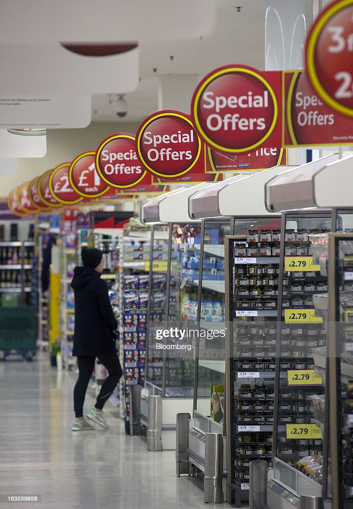 Signs alert customers to 'special offer' deals in the chilled section of a Tesco Plc supermarket in the borough of Kensington in London, U.K., on Tuesday, March 12, 2013. Tesco Plc, the U.K.'s largest grocer launched a 'Price Promise', its latest initiative offering to match the price of customers' purchases to that of it's rivals, including Wal-Mart Stores Inc.'s ASDA. Photographer: Simon Dawson/Bloomberg via Getty Images