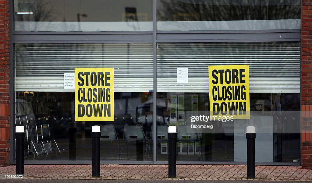 Signs alerting customers that the store will be closing down are seen in the window display of a Comet electronics store in Slough, U.K., on Friday, Nov. 23, 2012. Comet, a U.K. electronics chain, appointed Deloitte LLP as insolvency administrator, less than a year after being bought by private-equity firm OpCapita LLP. Photographer: Chris Ratcliffe/Bloomberg via Getty Images