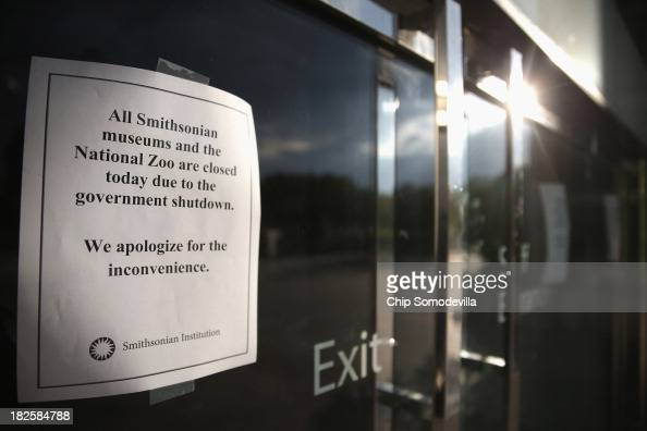 Signs alerting visitors that the National Museum of American History is closed are taped to the doors while the building remains indefinitely closed...
