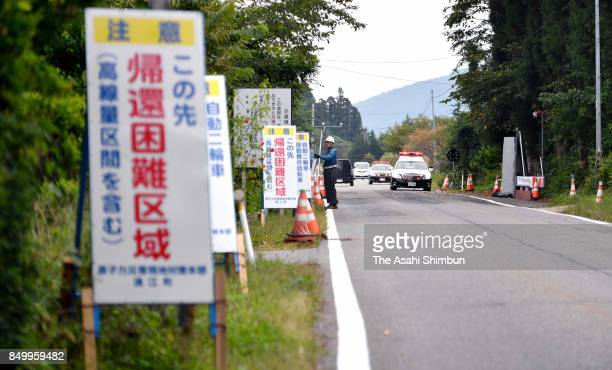 Signs along Route 114 warn of a difficulttoreturn zone ahead on September 20 2017 in Namie Fukushima Japan A 27kilometer section of National Round...