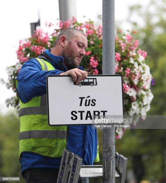 Signs are erected as new traffic restrictions and measures giving priority to buses come into effect in Dublin city today
