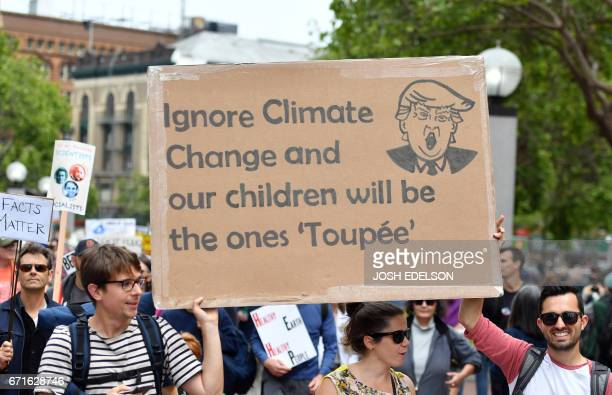 Signs are held during the March for Science in San Francisco California on April 22 2017 Thousands of people joined a global March for Science to...