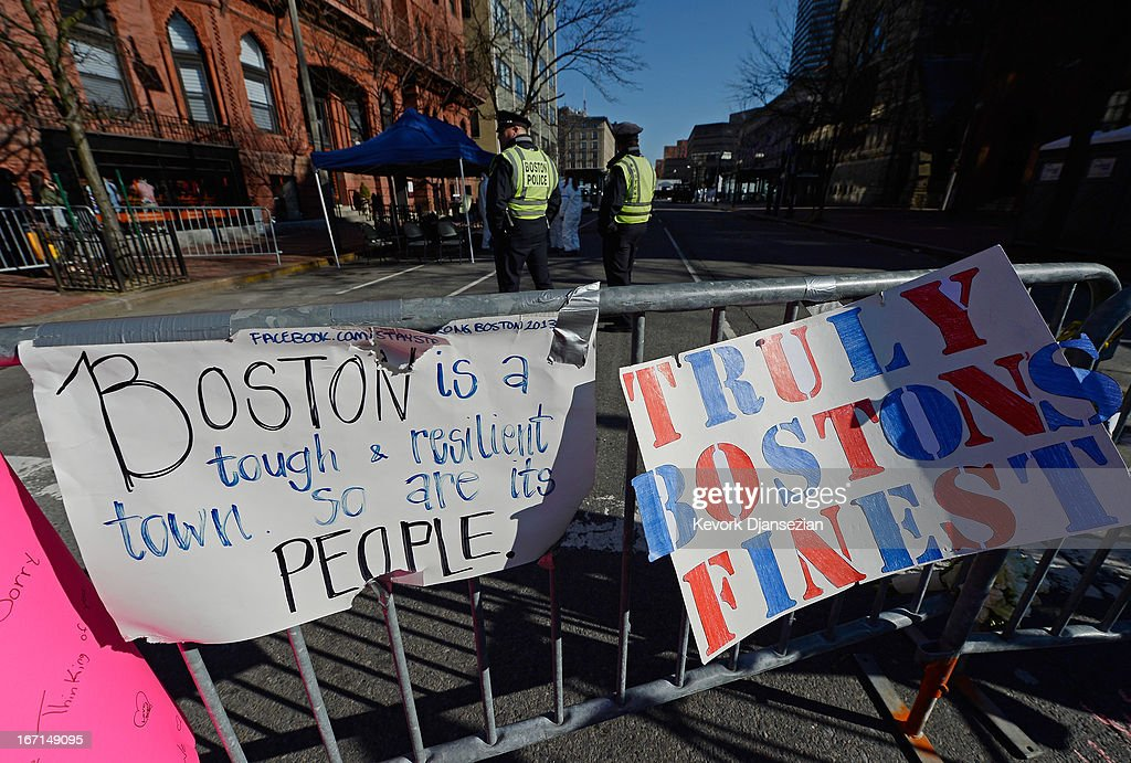 Signs are placed at a makeshift memorial for victims near the finish line of the Boston Marathon bombings two days after the second suspect was captured on April 21, 2013 in Boston, Massachusetts. A manhunt for Dzhokhar A. Tsarnaev, 19, a suspect in the Boston Marathon bombing ended after he was apprehended on a boat parked on a residential property in Watertown, Massachusetts. His brother Tamerlan Tsarnaev, 26, the other suspect, was shot and killed after a car chase and shootout with police. The bombing, on April 15 at the finish line of the marathon, killed three people and wounded at least 170.