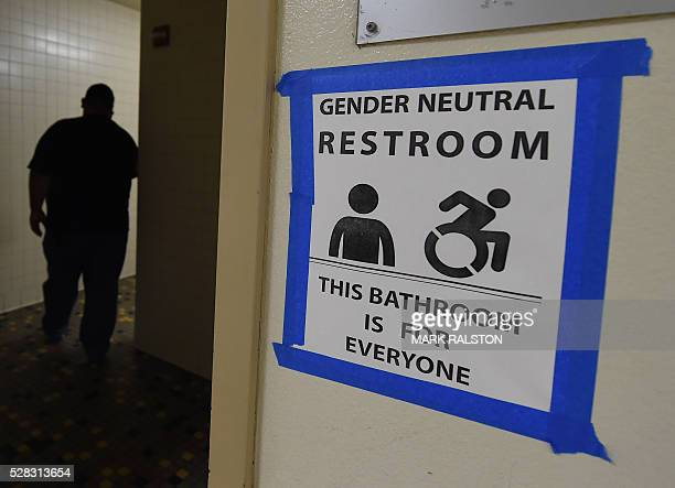 Signs are poseted outside the Santee High School's gender neutral restrooms at their campus in Los Angeles California on May 4 2016 There is an...