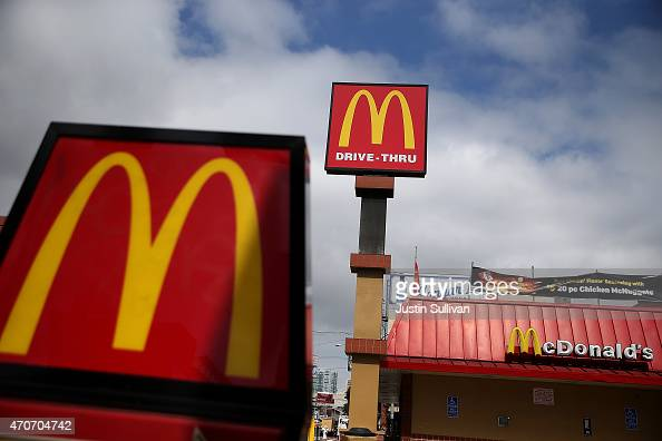 Signs are posted on the exterior of a McDonald's restaurant on April 22 2015 in San Francisco California McDonald's reported a decline in first...
