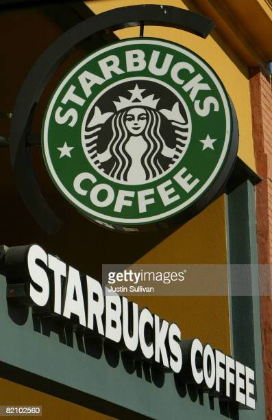 Signs are seen in the front of a Starbucks coffee shop January 22 2004 in San Francisco California In an effort to cut costs the coffee chain...