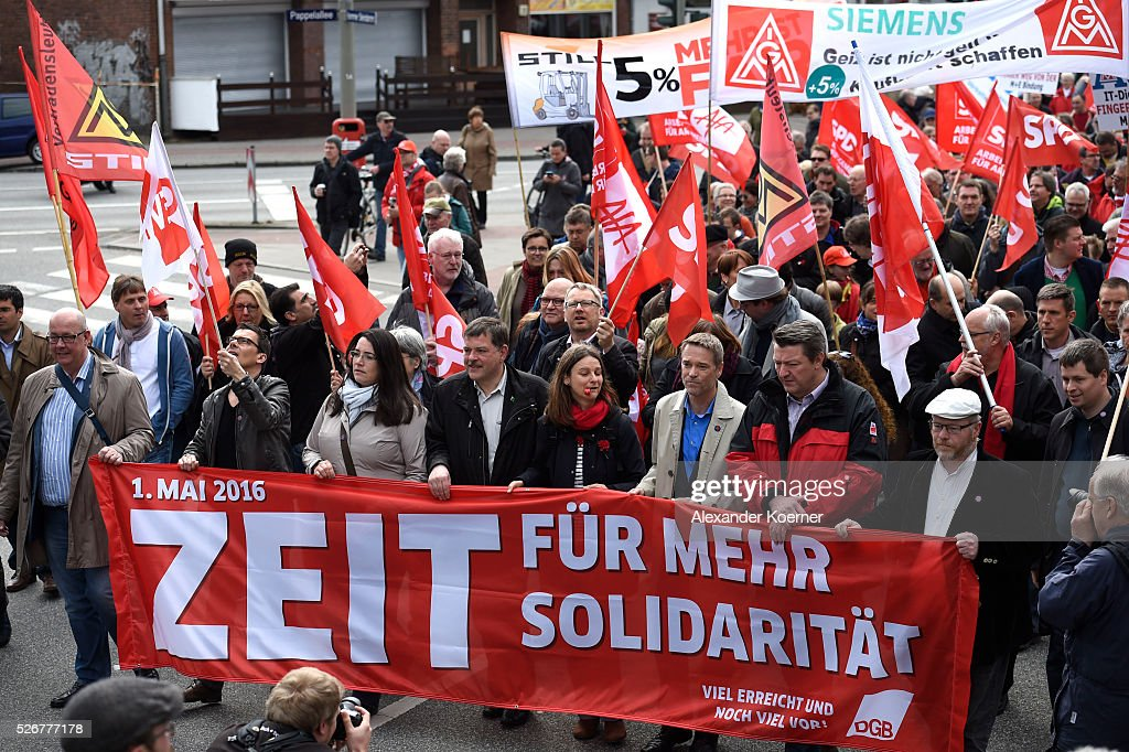 Signs are seen prior the German Confederation of Trade Unions (DGB - Deutscher Gewerkschaftsbund) march on May Day on May 1, 2016 in Hamburg, Germany. Tens of thousands of people across Germany are expected to participate in marches and gatherings by labor unions.