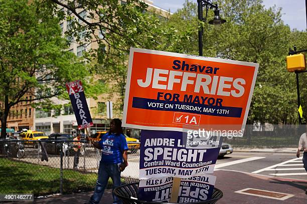 Signs backing mayoral candidates stand on the street in downtown on May 13 2014 in Newark New Jersey Voters in New Jersey's largest city go to the...