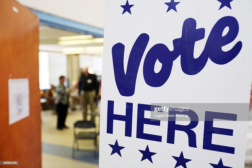 Signs direct voter to the polls at a polling station on November 4 2008 in Shallotte North Carolina After nearly two years of presidential...