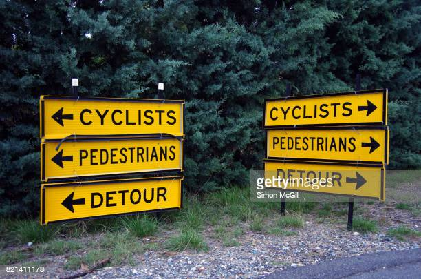 Signs directing cyclists and pedestrians to take a detour around roadworks in Canberra, Australian Capital Territory, Australia