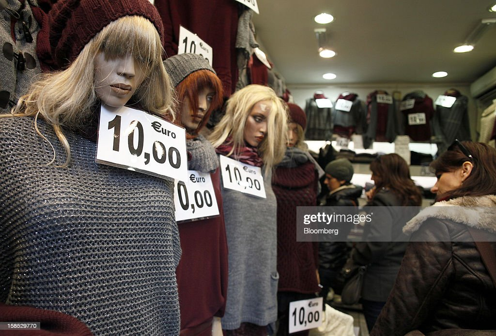 Signs display the cost in euros of women's knitwear at a store in Rome, Italy, on Tuesday, Dec. 18, 2012. Italian Prime Minister Mario Monti, who is under pressure from euro-area and business leaders to enter the Italian election campaign, plans to quit once parliament passes his budget this week. Photographer: Alessia Pierdomenico/Bloomberg via Getty Images