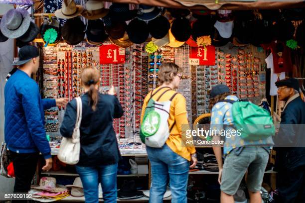Signs display the price in pounds sterling of goods displayed for sale on a stall at Portobello Road Market in the Notting Hill district of west...