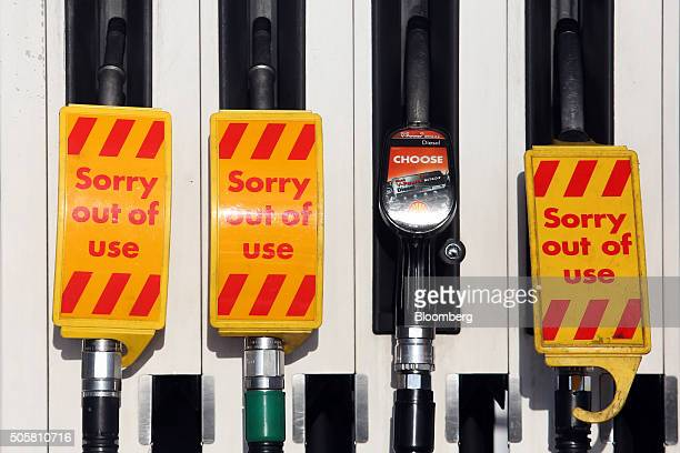 Signs displaying 'out of use' sit on fuel pumps on the forecourt of a Royal Dutch Shell Plc gas station in Hemel Hempstead UK on Wednesday Jan 20...