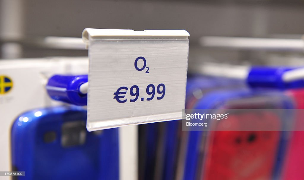 A signs displays the price in Euros of an item for sale inside an O2 Mobile Phone Store, part of Telefonica SA, on Grafton Street in Dublin, Ireland, on Wednesday, June 12, 2013. Telefonica SA, Europe's most indebted telephone company, is seeking initial bids for its Irish unit within the month, two people with knowledge of the matter said. Photographer: Aidan Crawley/Bloomberg via Getty Images
