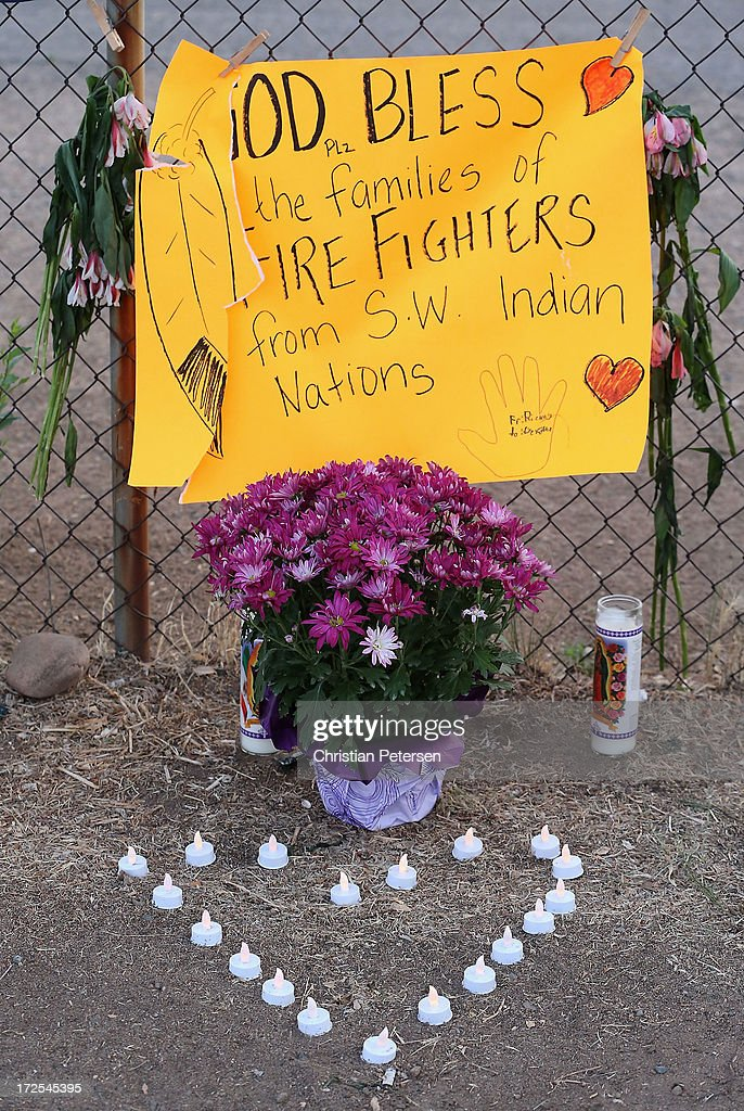 Signs, flowers and mementos adorn the outside of Station 7 on July 3, 2013 in Prescott, Arizona. Nineteen firefighters based out of Station 7 died battling a fast-moving wildfire near Yarnell, Arizona on June 30. Station 7 has been the home of the Granite Mountain Interagency Hotshot Crew since 2010.