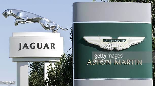 Signs fo a Jaguar and Aston Martin stand outside dealerships August 31 2006 in Troy Michigan Ford Motor Company announced today they are considering...