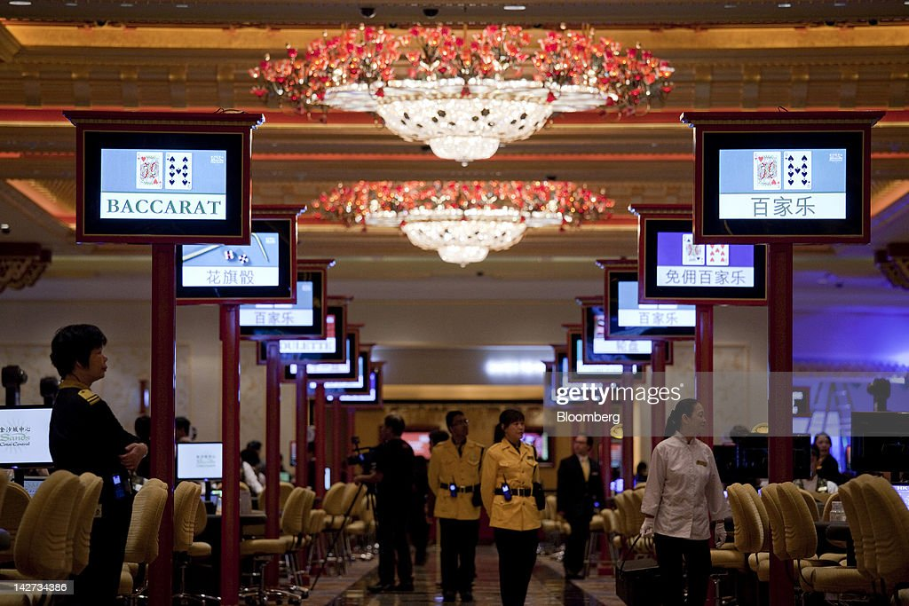Signs for Baccarat and Craps tables are displayed in the Sands Cotai Central casino resort in Macau, China, on Wednesday, April 11, 2012. Las Vegas Sands Corp. Chairman Sheldon Adelson plans to spend $35 billion on building Spanish gambling resorts over nine years and will add a new Macau location to expand globally. Photographer: Jerome Favre/Bloomberg via Getty Images