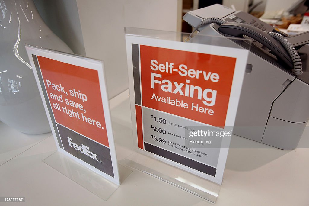 Signs for packing and faxing are displayed inside the new OfficeMax Inc. Business Solutions Center in Chicago, Illinois, U.S., on Tuesday, Aug. 27, 2013. The OfficeMax Business Solutions Center provides local businesses with services including designed marketing, web, document, IT and shipping service. Photographer: Tim Boyle/Bloomberg via Getty Images