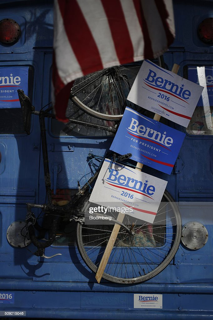 Signs for Senator Bernie Sanders, an independent from Vermont and 2016 Democratic presidential candidate, are displayed on the rear of a supporter's bus in downtown Manchester, New Hampshire, U.S., on Tuesday, Feb. 9, 2016. Voters in New Hampshire took to the polls today in the nation's first primary in the U.S. presidential race. Photographer: Luke Sharrett/Bloomberg via Getty Images