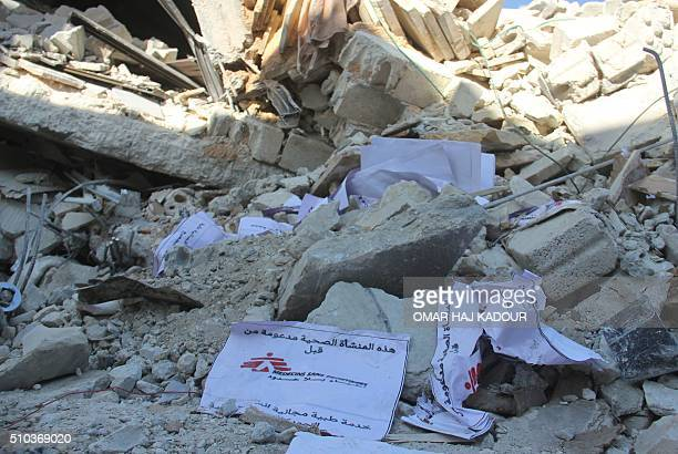 Signs from Doctors Without Borders lie amidst debris after a hospital supported by MSF was hit by suspected Russian air strikes near Maaret alNuman...