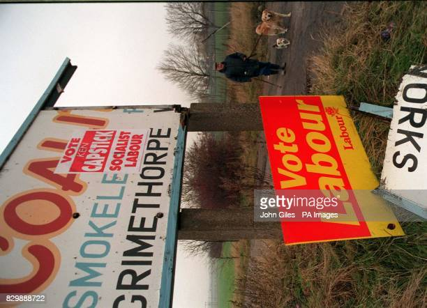 Signs from Grimethorpe where residents will get a chance tomorrow to pass their verdict on the Conservative Government that devastated the town with...