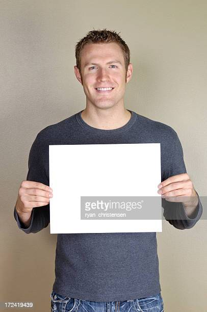 Signs - Handsome man holding blank white sign.
