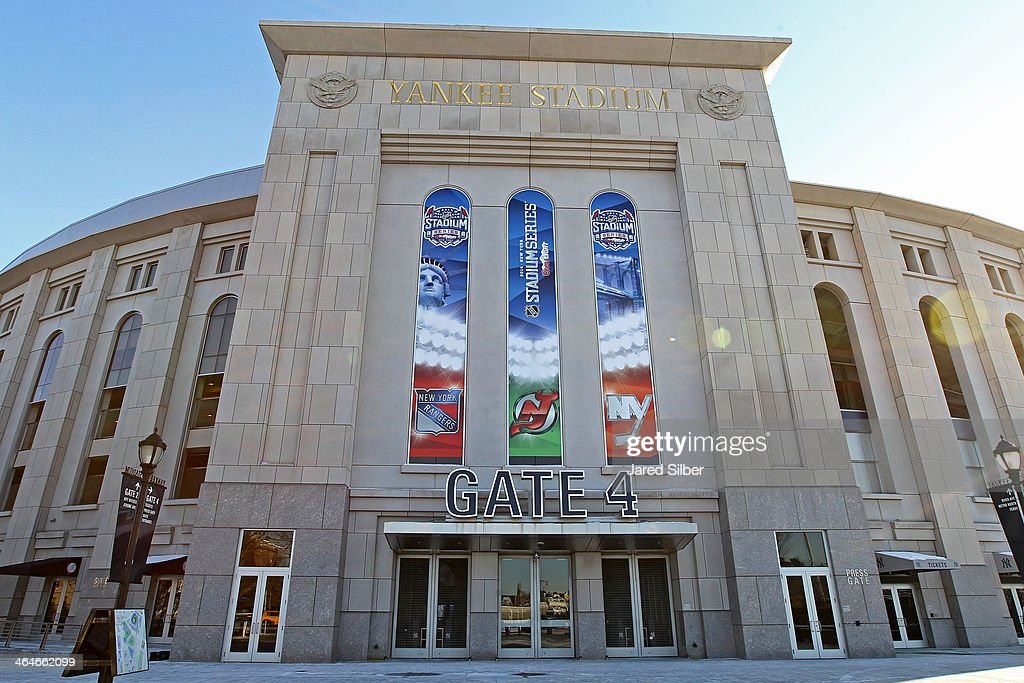 Signs hang over the Gate 4 entrance promoting the 2014 Coors Light Stadium Series Games at Yankee Stadium on January 23, 2014 in the Bronx borough of New York City. The games are scheduled to be played on Sunday, January 26, 2014 and Wednesday, January 29, 2014.
