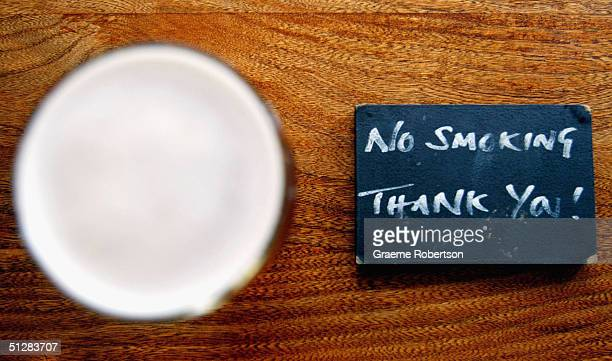 Signs highlighting the 'No Smoking' areas in the pub All BarOne on September 10 2004 north London The chain of popular pubs and restaurants have...