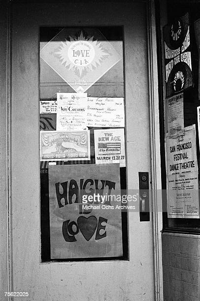 Signs in local businesses reflect the peaceandlove ethos in San Francisco California in the early summer 1967