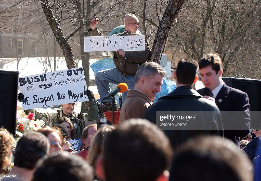 Signs in support of gay equal rights are visible as John North and Andrew Burgreen are married by New Paltz Mayor Jason West outside village hall...