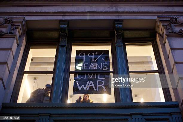 Signs in support of the Occupy Wall street movement are seen inside a classroom of the New at the intersection of 5th Avenue and West 14th Street in...